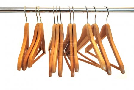 Photo for Wood coat hanger at a wardrobe over white background - Royalty Free Image