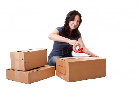 Woman taping moving storage boxes