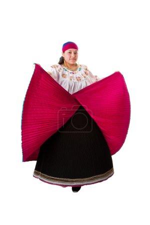 Beautiful Hispanic woman dancing in red with black...