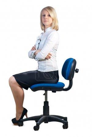 Photo for Attractive young caucasian businesswoman sitting in office chair. Isolated on white background. - Royalty Free Image
