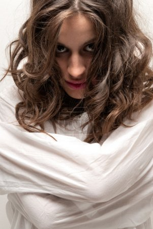 Photo for Young insane woman with straitjacket looking at camera close-up portrait - Royalty Free Image