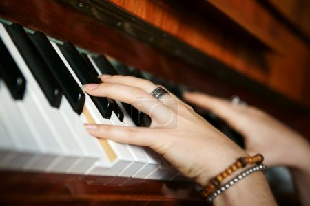 Hands playing music on the piano, hands and piano player, keyboa