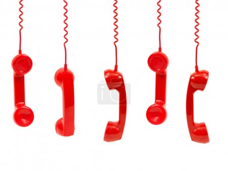 Photo for Hanging rotary telephone hand setsisolated against a white background - Royalty Free Image