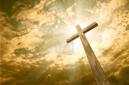 Photo for Wooden cross against the sky with shining rays - Royalty Free Image