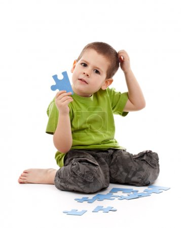 Boy with puzzles