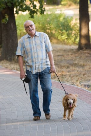 Smiling old senior with his dog.