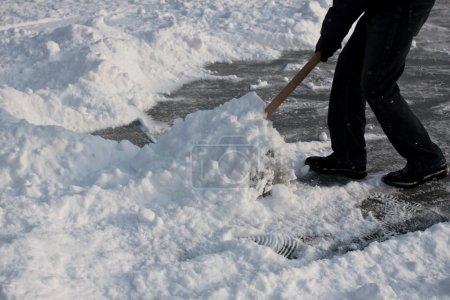 Shoveling snow.