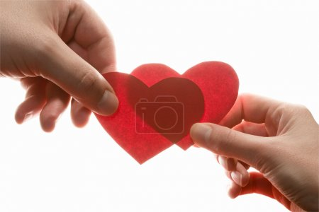 Photo for Female and man's hands with red hearts - Royalty Free Image