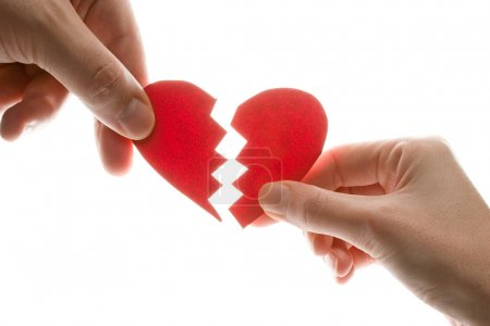 Photo for Female and man's hands with broken heart - Royalty Free Image