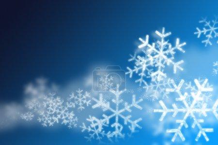Foto de Antecedentes de los copos de nieve sobre fondo azul - Imagen libre de derechos