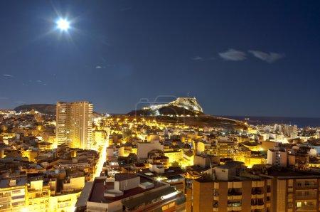 Night panorama city Alicante with castle Santa Barbara