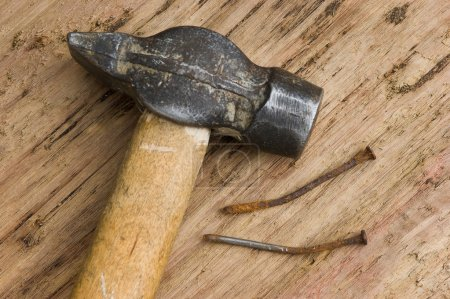 Hammer with a rusty nail