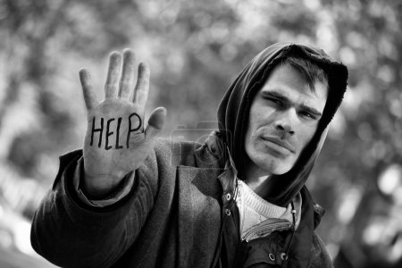 Photo for Young Homeless Men with hand outstretched: You can Help! - Royalty Free Image