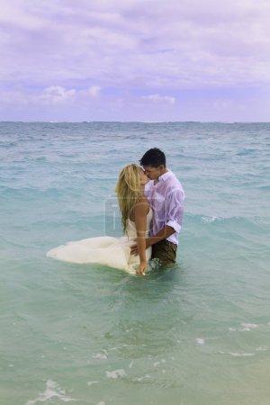 Wedding couple in the ocean