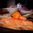 Plate of fresh smoked salmon with other fish in th...