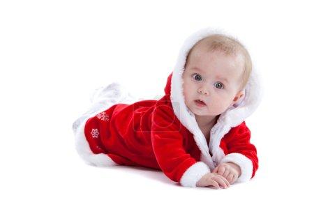 Foto de Pequeña Navidad buscando un poco sorprendido sobre fondo blanco - Imagen libre de derechos