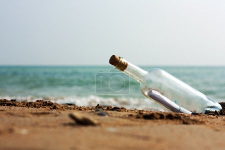 Photo for A Letter in a bottle on the shore,cast out by ocean or sea - Royalty Free Image