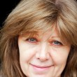 Portrait of nice cheerful middle aged woman on bla...