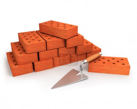 Trowel and stack of bricks isolated on white