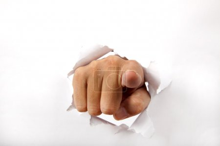 Photo for Hand break through the white paper with finger pointing to the you - Royalty Free Image
