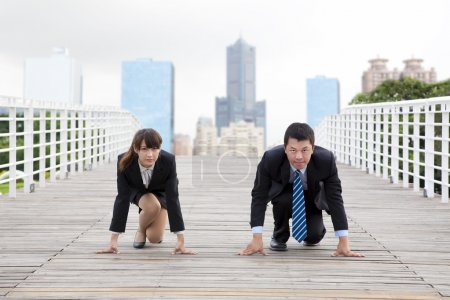 Photo for Business man and woman getting ready for race in business - Royalty Free Image