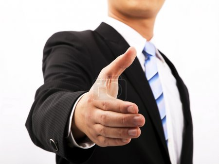 Close up of business man extending hand to shake
