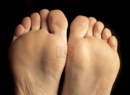 Bottom of her feet