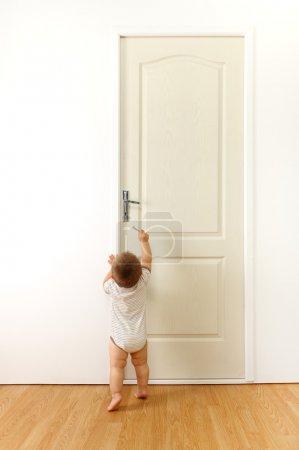 Baby in front of door