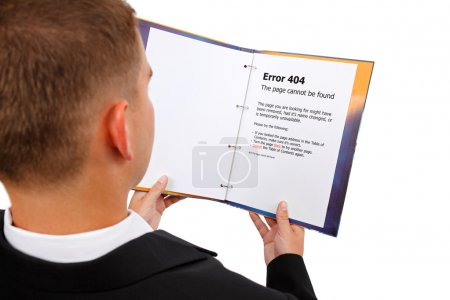 Photo for Man looking at book, error 404 page displayed. Metaphoric view of a missing document - Royalty Free Image