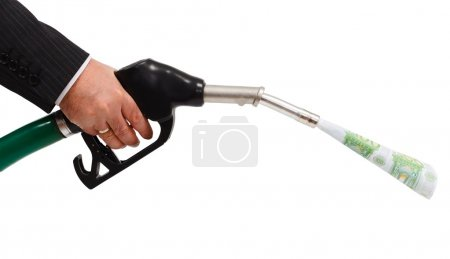 Photo for Hand holding gas nozzle, money pouring from pipe - Royalty Free Image