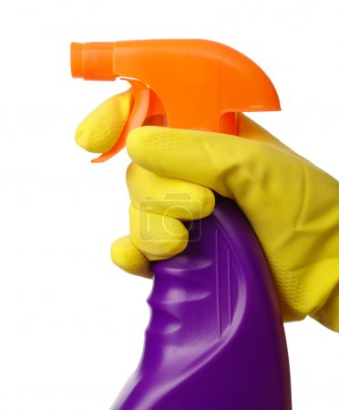 Photo for Chores - hand in yellow glove holds sprayer with chemical cleaner, isolated over white - Royalty Free Image
