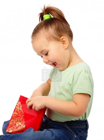 Photo for Cute little girl with red shopping bag, isolated over white - Royalty Free Image