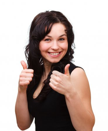 Photo for Young woman dressed in black is showing thumb up gesture, isolated over white - Royalty Free Image