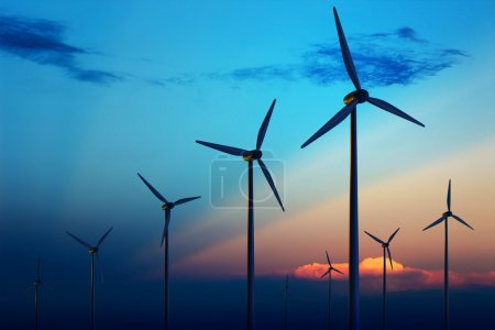 Photo for Wind turbine farm with rays of light at sunset - Royalty Free Image