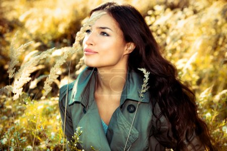 Photo for Young brunette woman portrait in autumn field - Royalty Free Image