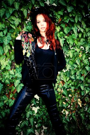 Red hair fashion woman in black with fashion acces...