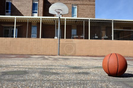 Photo for Outdoor basketball court in schoolyard. - Royalty Free Image
