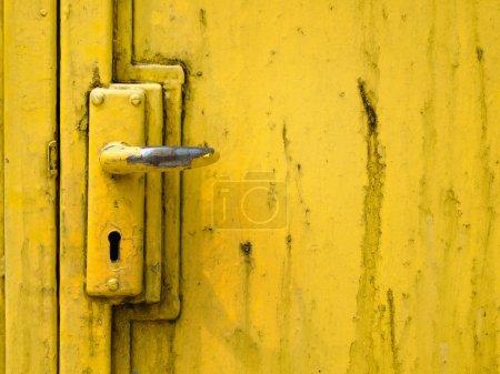 Photo for Door handle and steel door painted yellow - Royalty Free Image