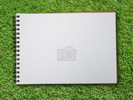 Note book on green grass