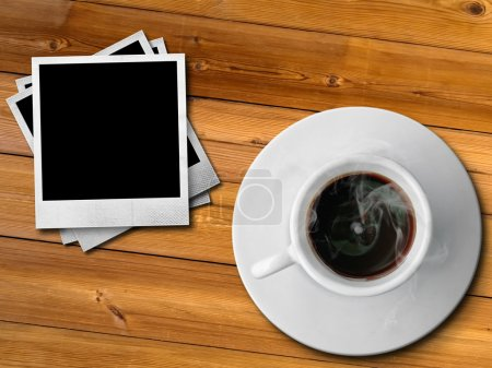 Photo for White cup of hot coffee and old paper photo frame on wood table - Royalty Free Image