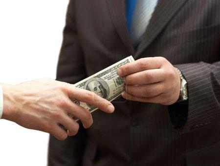 Photo pour Argent mains un homme à l'homme d'affaires - image libre de droit