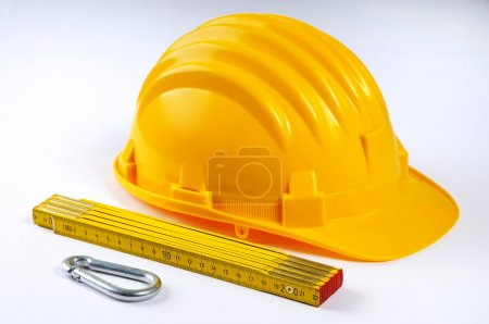 Yellow hard hat with some equipment
