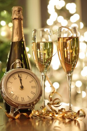 Photo for Champagne glasses ready to bring in the New Year - Royalty Free Image