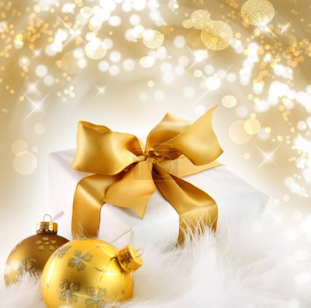 Photo for Gold ribbon gift with festive holiday background - Royalty Free Image