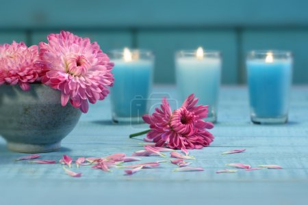 Photo for Pink chrysanthemum flowers in bowl of water with candles - Royalty Free Image