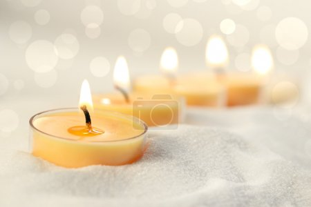 Votive candles in sand