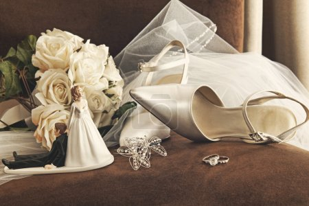 Photo for Bouquet of white roses, rings and satin wedding shoes on chair - Royalty Free Image