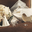 Bouquet of white roses, rings and satin wedding sh...