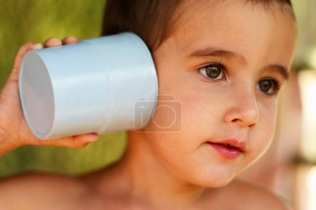 Boy with a toy communication device