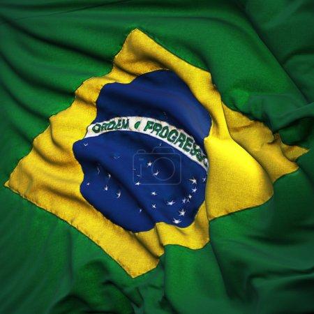 Flag of Brazil, fluttering in the breeze, backlit rising sun
